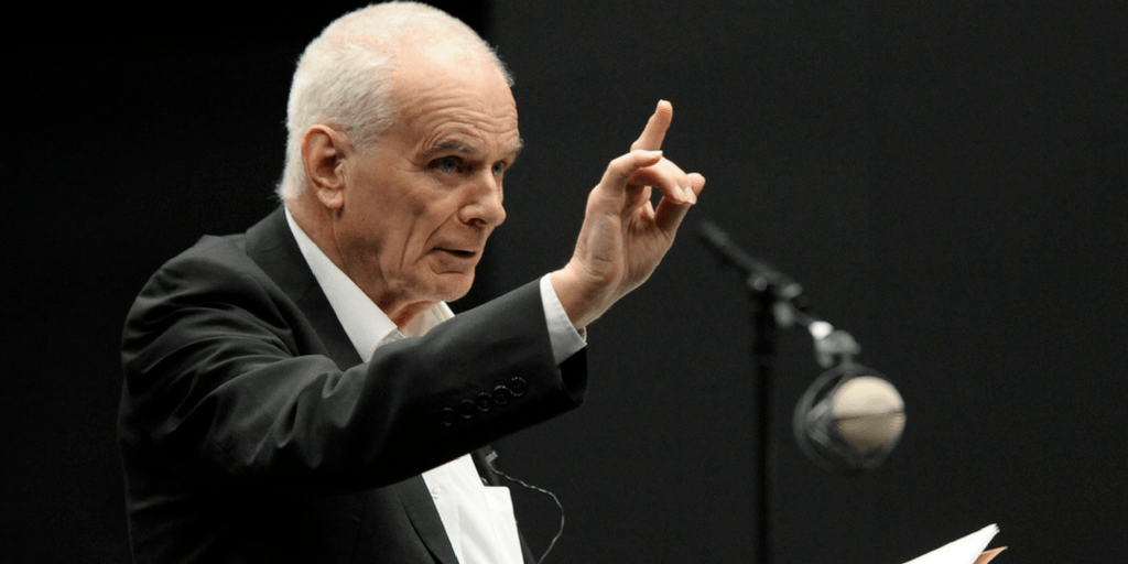 Peter Maxwell Davies talking in an auditorium